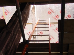 In the attic or roof insulation
