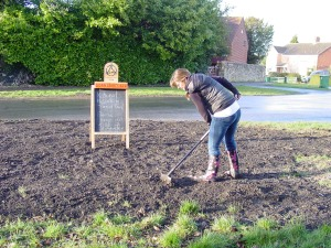 Raking and seeding the green 11.4.13008
