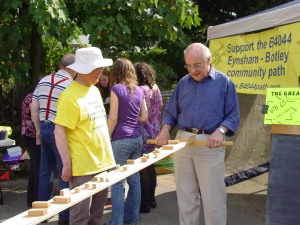 Rev. Brian Stops, Chairman of the Parish Council, had a go at the Community Path challenge